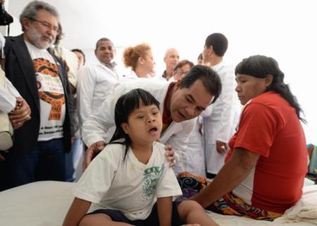 Brazilian government's More Doctors program visit a shelter for Brazil's indigenous Indians, in Brasilia on Sept. 6, 2013.